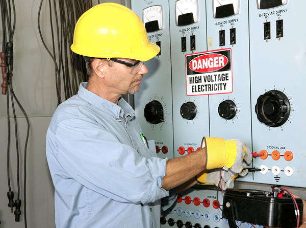 Electrician working on a commercial power distribution center