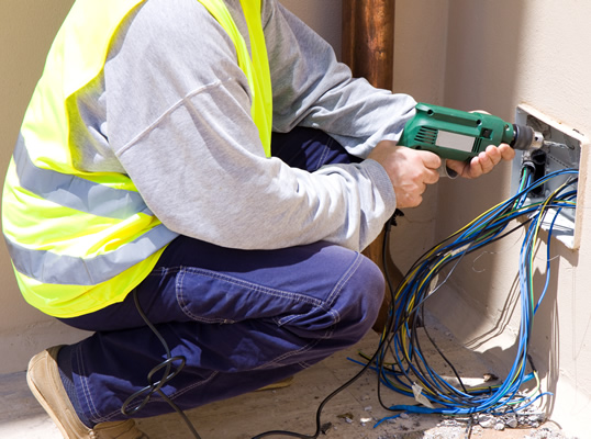 Electrican contractor pulling wires to find short